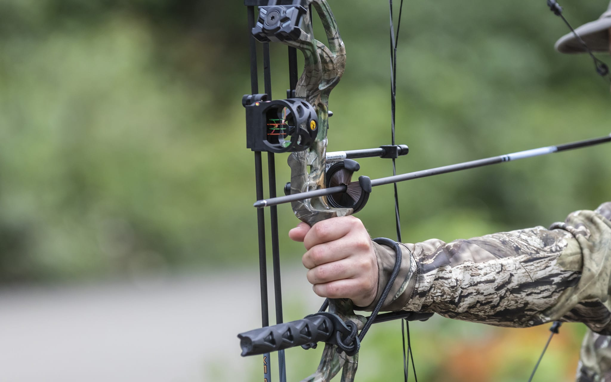 Someone Holding a Compound Hunting Bow